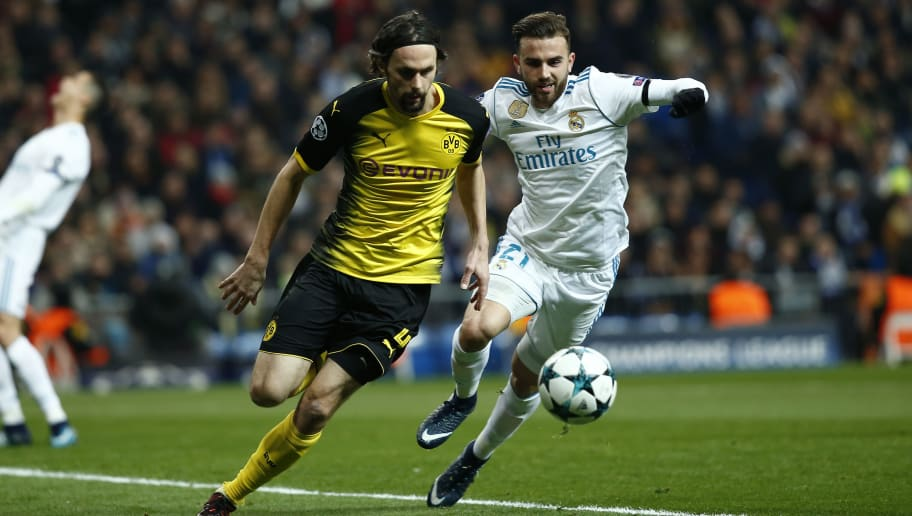 MADRID, SPAIN - DECEMBER 06: Neven Subotic of Borussia Dortmund is challenged by Borja Mayoral of Real Madrid during the UEFA Champions League group H match between Real Madrid and Borussia Dortmund at Estadio Santiago Bernabeu on December 6, 2017 in Madrid, Spain.  (Photo by Gonzalo Arroyo Moreno/Getty Images)