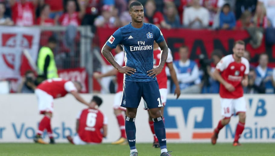 MAINZ, GERMANY - OCTOBER 14: Walace of Hamburger SV looks dejected after the second goal of Mainz during the Bundesliga match between 1. FSV Mainz 05 and Hamburger SV at Opel Arena on October 14, 2017 in Mainz, Germany.  (Photo by Christof Koepsel/Bongarts/Getty Images)