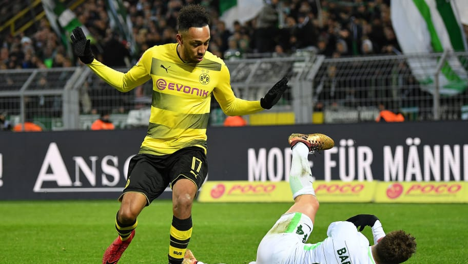 DORTMUND, GERMANY - DECEMBER 09: Pierre-Emerick Aubameyang of Dortmund (l) and Philipp Bargfrede of Bremen fights for the ball during the Bundesliga match between Borussia Dortmund and SV Werder Bremen at Signal Iduna Park on December 9, 2017 in Dortmund, Germany. (Photo by Stuart Franklin/Bongarts/Getty Images )