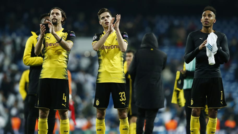 MADRID, SPAIN - DECEMBER 06: Neven Subotic of Borussia Dortmund, Julian Weigl of Borussia Dortmund and Pierre-Emerick Aubameyang of Borussia Dortmund clap the fans after the UEFA Champions League group H match between Real Madrid and Borussia Dortmund at Estadio Santiago Bernabeu on December 6, 2017 in Madrid, Spain.  (Photo by Gonzalo Arroyo Moreno/Getty Images)