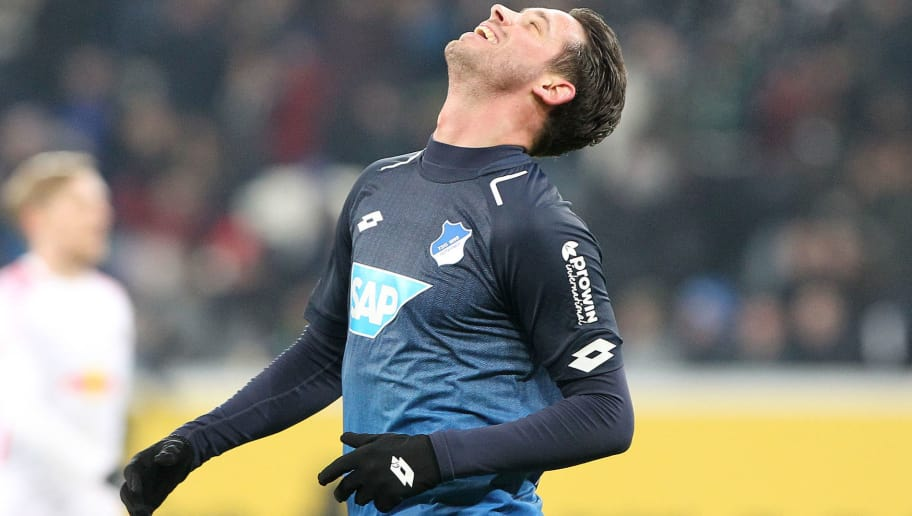 Hoffenheim's German forward Mark Uth celebrates after scoring the fourth goal during the German First division Bundesliga football match TSG 1899 Hoffenheim vs RB Leipzig on December 2, 2017 in Sinsheim, southwest Germany. / AFP PHOTO / Daniel ROLAND / RESTRICTIONS: DURING MATCH TIME: DFL RULES TO LIMIT THE ONLINE USAGE TO 15 PICTURES PER MATCH AND FORBID IMAGE SEQUENCES TO SIMULATE VIDEO. == RESTRICTED TO EDITORIAL USE == FOR FURTHER QUERIES PLEASE CONTACT DFL DIRECTLY AT + 49 69 650050         (Photo credit should read DANIEL ROLAND/AFP/Getty Images)