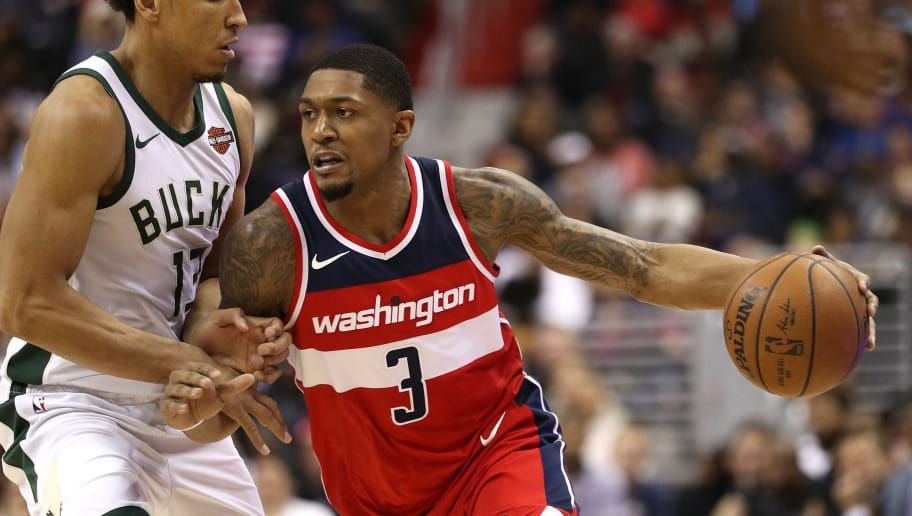 WASHINGTON, DC - JANUARY 15: Bradley Beal #3 of the Washington Wizards dribbles in front of Malcolm Brogdon #13 of the Milwaukee Bucks during the second half at Capital One Arena on January 15, 2018 in Washington, DC. NOTE TO USER: User expressly acknowledges and agrees that, by downloading and or using this photograph, User is consenting to the terms and conditions of the Getty Images License Agreement. (Photo by Patrick Smith/Getty Images)