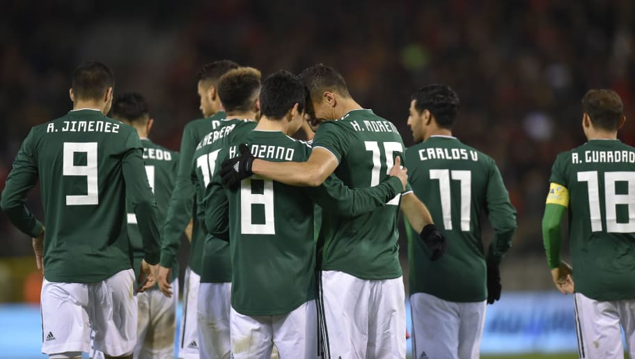 Mexico's forward Hirving Lozano (C) celebrates with teammates after scoring a goal during the international friendly football match between Belgium and Mexico at the King Baudouin Stadium in Brussels on November 10, 2017.  / AFP PHOTO / JOHN THYS        (Photo credit should read JOHN THYS/AFP/Getty Images)