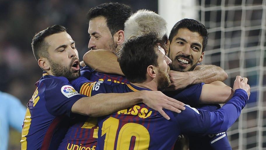 f43846f237e Barcelona s Uruguayan forward Luis Suarez (R) celebrates with teammates  after scoring a goal during