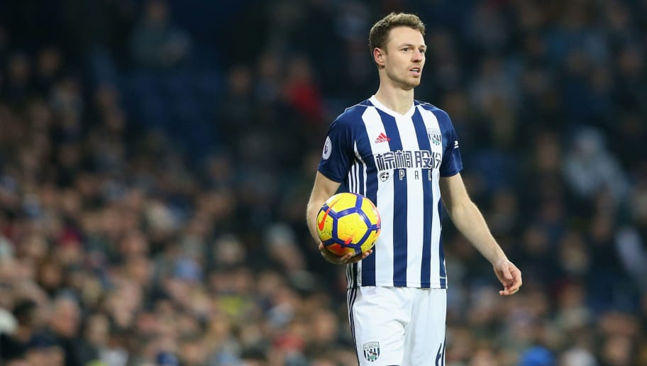 WEST BROMWICH, ENGLAND - JANUARY 13:  Jonny Evans of West Bromwich Albion takes a throw in during the Premier League match between West Bromwich Albion and Brighton and Hove Albion at The Hawthorns on January 13, 2018 in West Bromwich, England.  (Photo by Alex Livesey/Getty Images)