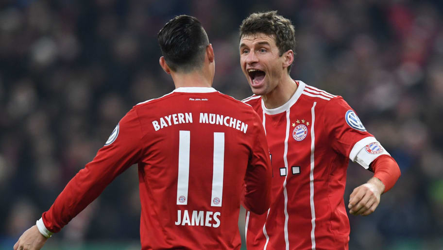 Bayern Munich's striker Thomas Mueller (R) is congratulated by his teammate Colombian James Rodriguez (L) after scoring the second goal during the German football Cup DFB Pokal round of sixteen match Bayern Munich vs Borussia Dortmund on December 20, 2017 in Munich.  Bayern Munich's striker Thomas Mueller (R) is cnongratulated by his teammate Colombian James Rodriguez (L) after scoring the second goal during the German football Cup DFB Pokal round of sixteen match Bayern Munich vs Borussia Dortmund on December 20, 2017 in Munich.  / AFP PHOTO / Christof STACHE / RESTRICTIONS: ACCORDING TO DFB RULES IMAGE SEQUENCES TO SIMULATE VIDEO IS NOT ALLOWED DURING MATCH TIME. MOBILE (MMS) USE IS NOT ALLOWED DURING AND FOR FURTHER TWO HOURS AFTER THE MATCH. == RESTRICTED TO EDITORIAL USE == FOR MORE INFORMATION CONTACT DFB DIRECTLY AT +49 69 67880   /         (Photo credit should read CHRISTOF STACHE/AFP/Getty Images)