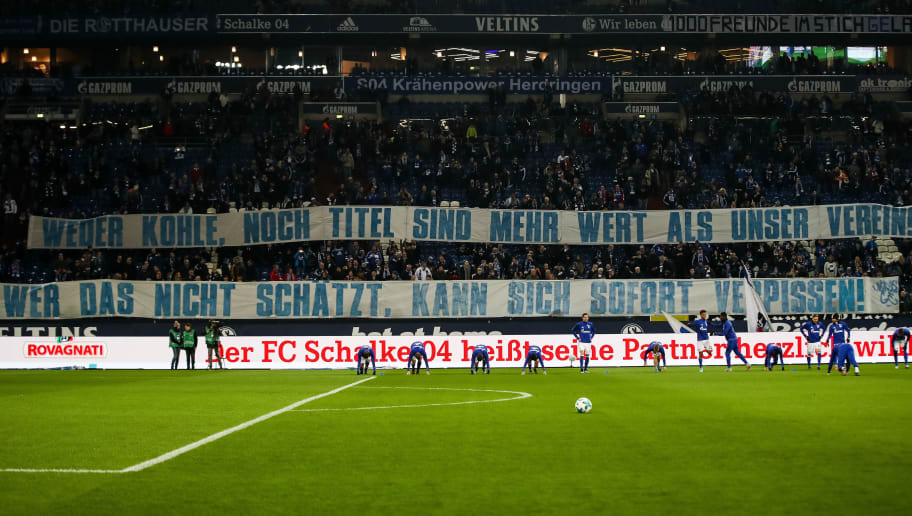 GELSENKIRCHEN, GERMANY - JANUARY 21: A banner saying 'Neither money, not the titles are more worth than our team. Who can not appreciate this, should leave' for player Leon Goretzka of Schalke who is suppose to change to Bayer Munich next season is displayed by fans prior the Bundesliga match between FC Schalke 04 and Hannover 96 at Veltins-Arena on January 21, 2018 in Gelsenkirchen, Germany. (Photo by Maja Hitij/Bongarts/Getty Images)