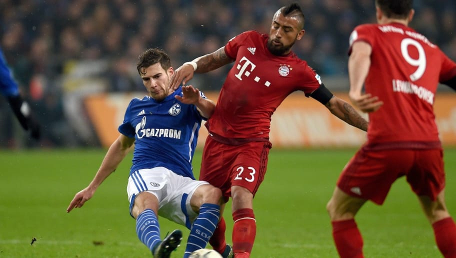 Bayern Munich's Chilean midfielder Arturo Vidal (R) and Schalke's midfielder Leon Goretzka vie for the ball during the German first division Bundesliga football match FC Schalke 04 vs FC Bayern Munich in Gelsenkirchen, western Germany, on November 21, 2015. Bayern Munich won the match 1-3.   AFP PHOTO / PATRIK STOLLARZ  RESTRICTIONS: DURING MATCH TIME: DFL RULES TO LIMIT THE ONLINE USAGE TO 15 PICTURES PER MATCH AND FORBID IMAGE SEQUENCES TO SIMULATE VIDEO.  ==RESTRICTED TO EDITORIAL USE == FOR FURTHER QUERIES PLEASE CONTACT THE DFL DIRECTLY AT + 49 69 650050.        (Photo credit should read PATRIK STOLLARZ/AFP/Getty Images)