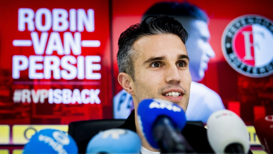 Robin van Persie, 34, new player of Dutch Eredivisie team Feyenoord Rotterdam, is presented to the press after signing a 18 month contract in Rotterdam on  January 22, 2018. / AFP PHOTO / ANP / Remko DE WAAL / Netherlands OUT        (Photo credit should read REMKO DE WAAL/AFP/Getty Images)
