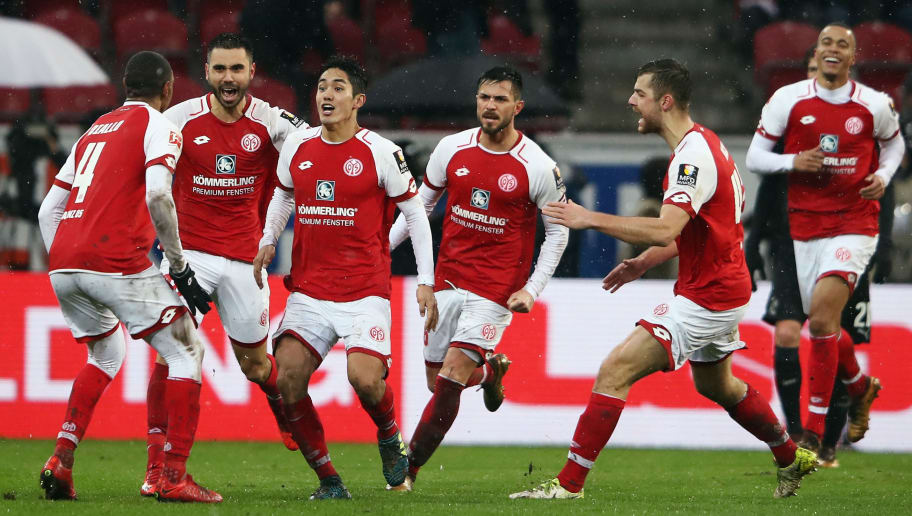 MAINZ, GERMANY - JANUARY 20:  Yoshinori Muto (3L) of Mainz celebrates his team's second goal with team mates during the Bundesliga match between 1. FSV Mainz 05 and VfB Stuttgart at Opel Arena on January 20, 2018 in Mainz, Germany.  (Photo by Alex Grimm/Bongarts/Getty Images)