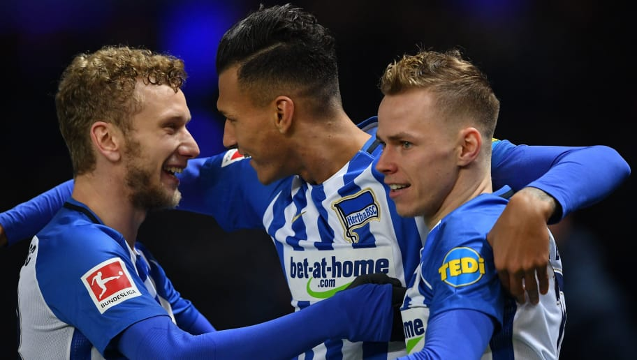 BERLIN, GERMANY - JANUARY 19:  Davie Selke of Berlin celebrates scoring his goal with Fabian Lustenberger and Ondrej Duda during the Bundesliga match between Hertha BSC and Borussia Dortmund at Olympiastadion on January 19, 2018 in Berlin, Germany.  (Photo by Stuart Franklin/Bongarts/Getty Images)