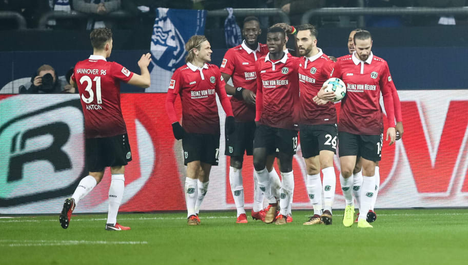 GELSENKIRCHEN, GERMANY - JANUARY 21: Team of Hannover celebrates after scoring the equalizing goal to make it 1-1- during the Bundesliga match between FC Schalke 04 and Hannover 96 at Veltins-Arena on January 21, 2018 in Gelsenkirchen, Germany. (Photo by Maja Hitij/Bongarts/Getty Images)