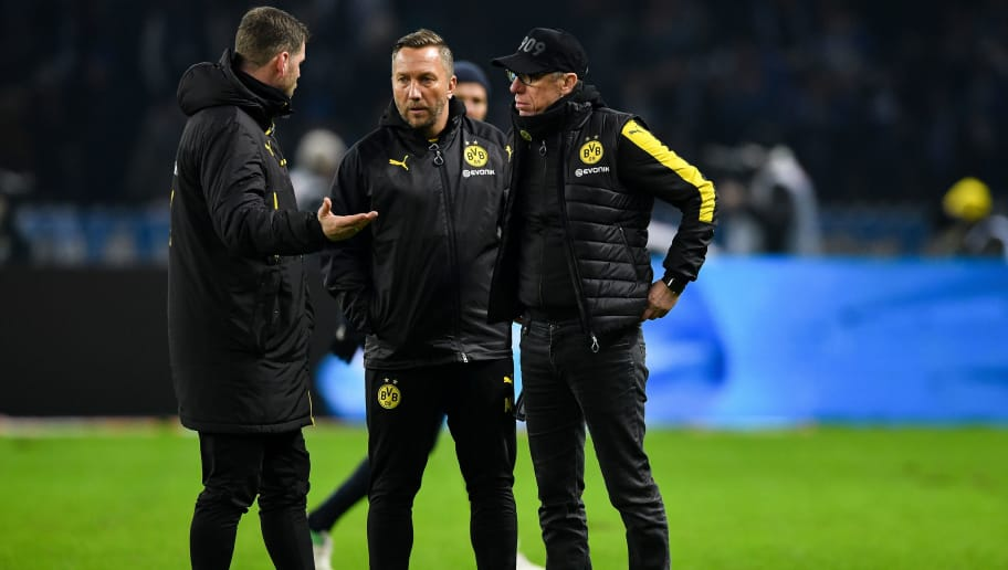 BERLIN, GERMANY - JANUARY 19: Head coach Peter Stoeger of Dortmund (R) reacts after the Bundesliga match between Hertha BSC and Borussia Dortmund at Olympiastadion on January 19, 2018 in Berlin, Germany. (Photo by Stuart Franklin/Bongarts/Getty Images)