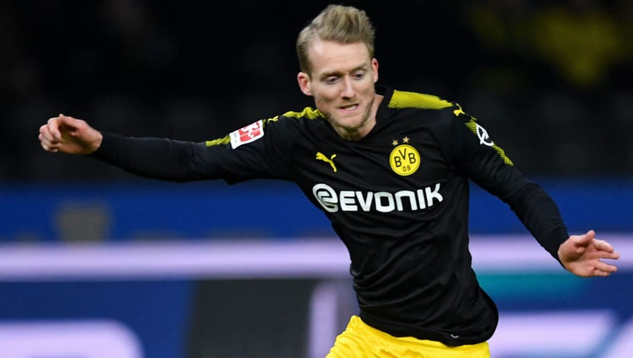 BERLIN, GERMANY - JANUARY 19: Andre Schurrle #21 of Borussia Dortmund and Fabian Lustenberger #28 of Hertha Berlin battle for the ball during the Bundesliga match between Hertha BSC and Borussia Dortmund at Olympiastadion on January 19, 2018 in Berlin, Germany. (Photo by Stuart Franklin/Bongarts/Getty Images)