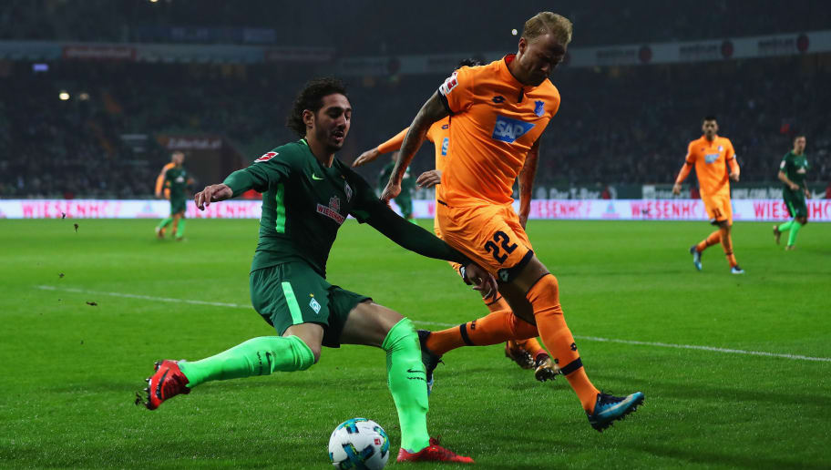 BREMEN, GERMANY - JANUARY 13:  Ishak Belfodil of Werder Bremen battles for the ball with Kevin Vogt of TSG 1899 Hoffenheim during the Bundesliga match between SV Werder Bremen and TSG 1899 Hoffenheim at Weserstadion on January 13, 2018 in Bremen, Germany.  (Photo by Dean Mouhtaropoulos/Bongarts/Getty Images)