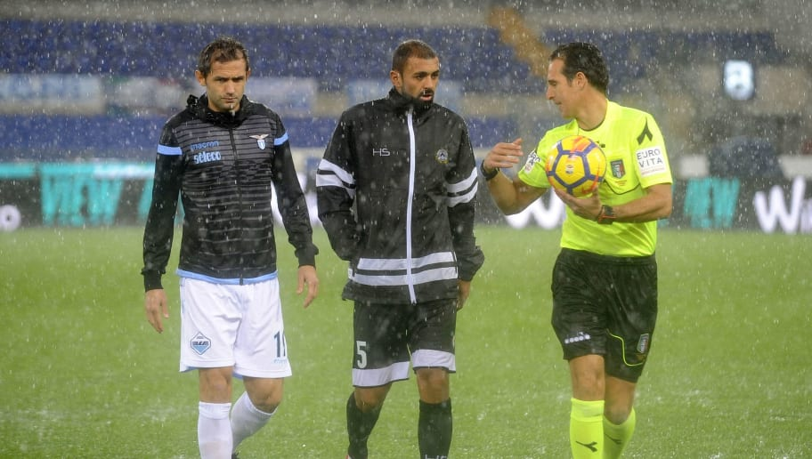 ROME, ROMA - NOVEMBER 05:  The referee Luca Banti with the two captains Senad Lulic of SS Lazio and Larangeria Danilo of Udinese Calcio make the match before the match because of the heavy rain on Rome the Serie A match between SS Lazio and Udinese Calcio at Stadio Olimpico on November 5, 2017 in Rome, Italy.  (Photo by Marco Rosi/Getty Images)