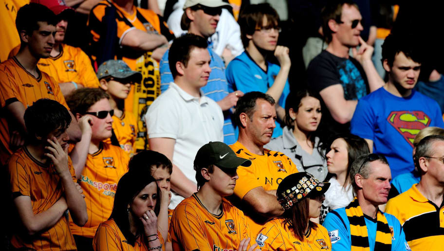 HULL, ENGLAND - APRIL 24:  Hull City fans look dejected as they watch their team from the stands during the Barclays Premier League match between Hull City and Sunderland at the KC Stadium on April 24, 2010 in Hull, England.  (Photo by Jamie McDonald/Getty Images)