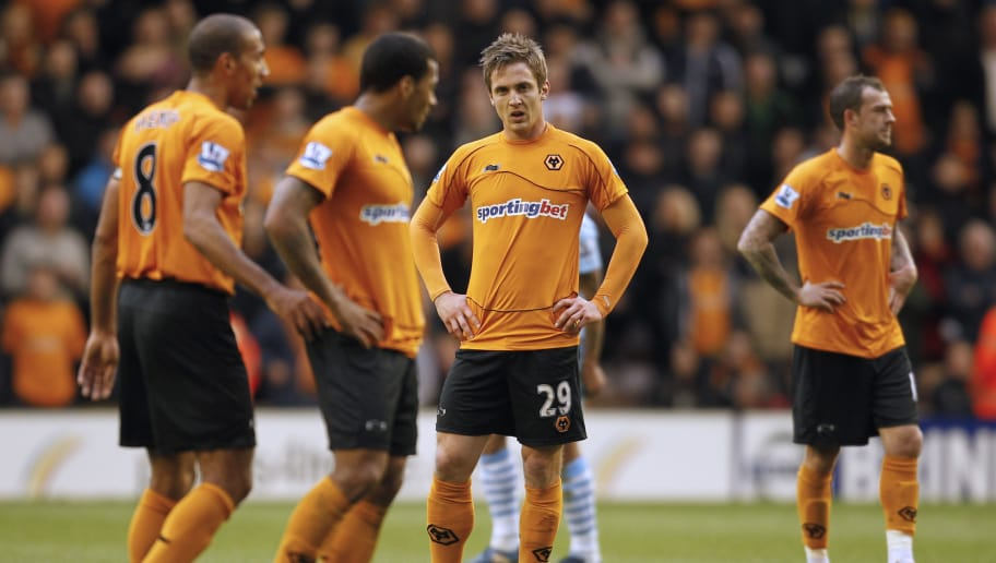 """Wolverhampton Wanderers's Kevin Doyle (c) reacts after the second goal is scored by \Manchester City's French player Samir Nasri (not pictured) during an English Premier League football match between Wolverhampton Wanderers and Manchester City at Molineux Stadium in Wolverhampton, England on April 22, 2012. AFP PHOTO/IAN KINGTON  RESTRICTED TO EDITORIAL USE. No use with unauthorised audio, video, data, fixture lists, club/league logos or """"live"""" services. Online in-match use limited to 45 images, no video emulation. No use in betting, games or single club/league/player publications. (Photo credit should read IAN KINGTON/AFP/Getty Images)"""