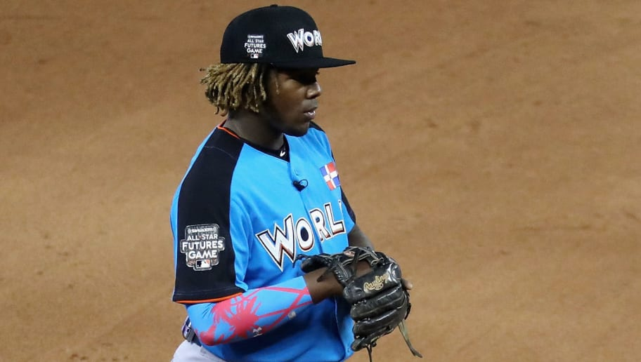 MIAMI, FL - JULY 09:  Vladimir Guerrero Jr. #27 of the Toronto Blue Jays and the World Team looks on against the U.S. Team during the SiriusXM All-Star Futures Game at Marlins Park on July 9, 2017 in Miami, Florida.  (Photo by Rob Carr/Getty Images)