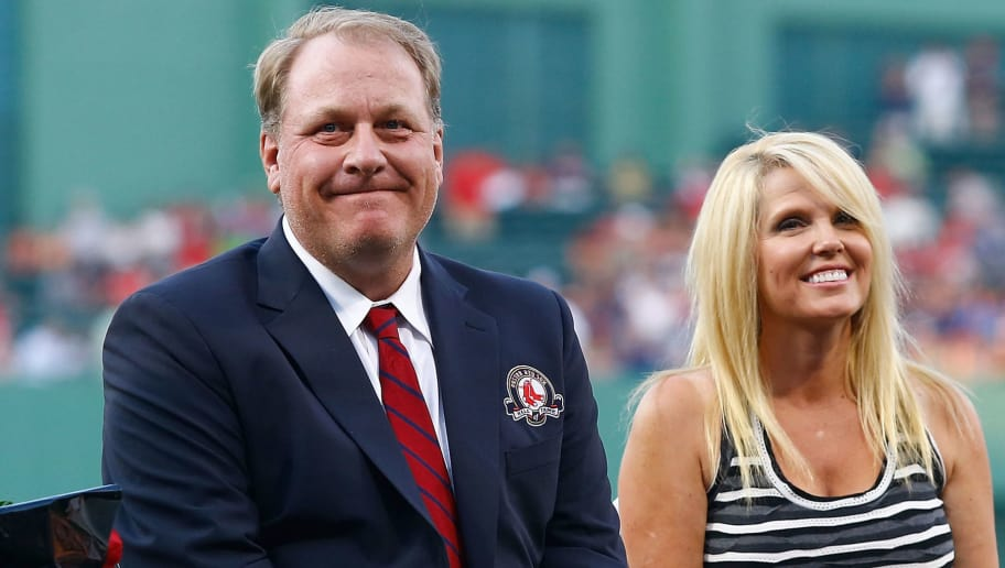 BOSTON, MA - AUGUST 03:  Former Boston Red Sox pitcher Curt Schilling #38 sits with his wife, Shonda Schilling, while being inducted into the Red Sox Hall of Fame prior to the game against the Minnesota Twins during the game on August 3, 2012 at Fenway Park in Boston, Massachusetts.  (Photo by Jared Wickerham/Getty Images)