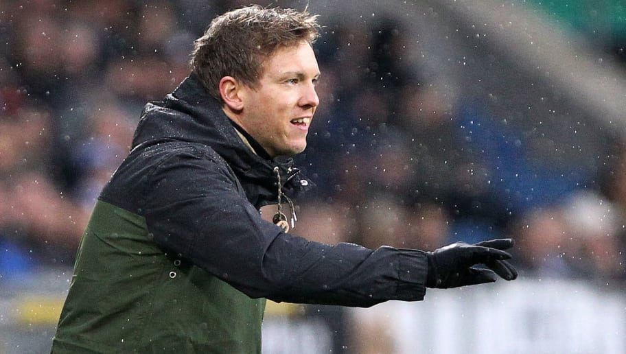 Hoffenheim's German head coach Julian Nagelsmann reacts during the German First division Bundesliga football match TSG 1899 Hoffenheim vs Bayer 04 Leverkusen in Sinsheim, southwestern Germany, on January 20, 2018. / AFP PHOTO / Amelie QUERFURTH / RESTRICTIONS: DURING MATCH TIME: DFL RULES TO LIMIT THE ONLINE USAGE TO 15 PICTURES PER MATCH AND FORBID IMAGE SEQUENCES TO SIMULATE VIDEO. == RESTRICTED TO EDITORIAL USE == FOR FURTHER QUERIES PLEASE CONTACT DFL DIRECTLY AT + 49 69 650050         (Photo credit should read AMELIE QUERFURTH/AFP/Getty Images)