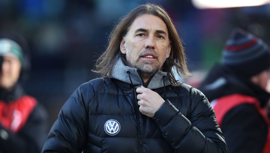 WOLFSBURG, GERMANY - JANUARY 20: Head coach Martin Schmidt of Wolfsburg enters the pitch prior to the Bundesliga match between VfL Wolfsburg and Eintracht Frankfurt at Volkswagen Arena on January 20, 2018 in Wolfsburg, Germany. (Photo by Ronny Hartmann/Bongarts/Getty Images)