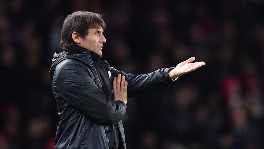 Chelsea's Italian head coach Antonio Conte gestures during the League Cup semi-final football match between Arsenal and Chelsea at the Emirates Stadium in London on January 24, 2018.  / AFP PHOTO / Ben STANSALL / RESTRICTED TO EDITORIAL USE. No use with unauthorized audio, video, data, fixture lists, club/league logos or 'live' services. Online in-match use limited to 75 images, no video emulation. No use in betting, games or single club/league/player publications.  /         (Photo credit should read BEN STANSALL/AFP/Getty Images)