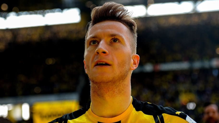 Dortmund's forward Marco Reus celebrates scoring 1:0 during the German first division Bundesliga football match between Borussia Dortmund and TSG 1899 Hoffenheim on May 6, 2017 in Dortmund, western Germany.  / AFP PHOTO / SASCHA SCHUERMANN / RESTRICTIONS: DURING MATCH TIME: DFL RULES TO LIMIT THE ONLINE USAGE TO 15 PICTURES PER MATCH AND FORBID IMAGE SEQUENCES TO SIMULATE VIDEO. == RESTRICTED TO EDITORIAL USE == FOR FURTHER QUERIES PLEASE CONTACT DFL DIRECTLY AT + 49 69 650050         (Photo credit should read SASCHA SCHUERMANN/AFP/Getty Images)