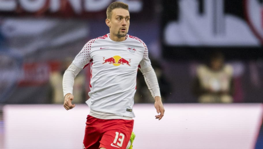 Leipzig´s Austrian midfielder Stefan Ilsanker plays the ball during the German first division Bundesliga football match between RB Leipzig and Mainz 05 in Leipzig, eastern Germany on December 9, 2017.  / AFP PHOTO / ROBERT MICHAEL / RESTRICTIONS: DURING MATCH TIME: DFL RULES TO LIMIT THE ONLINE USAGE TO 15 PICTURES PER MATCH AND FORBID IMAGE SEQUENCES TO SIMULATE VIDEO. == RESTRICTED TO EDITORIAL USE == FOR FURTHER QUERIES PLEASE CONTACT DFL DIRECTLY AT + 49 69 650050         (Photo credit should read ROBERT MICHAEL/AFP/Getty Images)