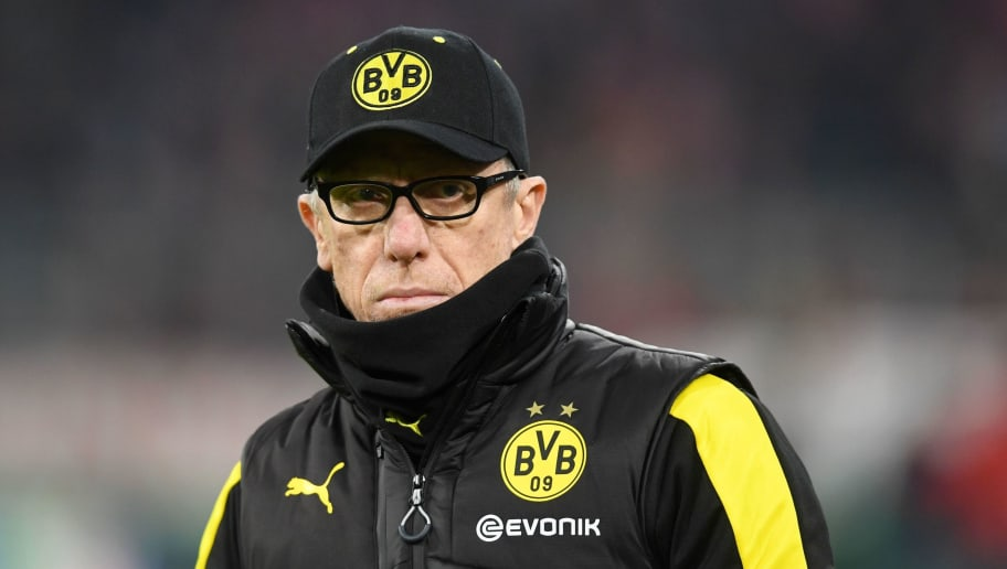 Dortmund's Austrian headcoach Peter Stoeger waits before the German football Cup DFB Pokal round of sixteen match Bayern Munich vs Dortmund on December 20, 2017 in Munich.  / AFP PHOTO / Christof STACHE / RESTRICTIONS: ACCORDING TO DFB RULES IMAGE SEQUENCES TO SIMULATE VIDEO IS NOT ALLOWED DURING MATCH TIME. MOBILE (MMS) USE IS NOT ALLOWED DURING AND FOR FURTHER TWO HOURS AFTER THE MATCH. == RESTRICTED TO EDITORIAL USE == FOR MORE INFORMATION CONTACT DFB DIRECTLY AT +49 69 67880   /         (Photo credit should read CHRISTOF STACHE/AFP/Getty Images)