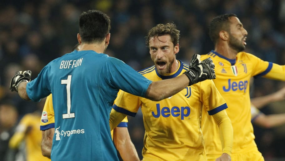 Juventus' midfielder from Italy Claudio Marchisio (C) and Juventus' goalkeeper from Italy Gianluigi Buffon celebrate at the end of the Italian Serie A football match Napoli vs Juventus on December 1, 2017 at the San Paolo stadium in Naples. Juventus won 0-1. / AFP PHOTO / CARLO HERMANN        (Photo credit should read CARLO HERMANN/AFP/Getty Images)