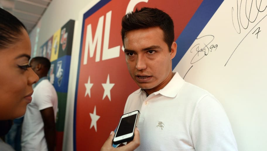 Chivas USA forward Erick Cubo Torres speaks to journalists during an event to unveil Major League Soccer (MLS) new logo, in New York on September 18, 2014. MLS unveiled the new logo ahead of its 20th season. AFP PHOTO/Jewel Samad        (Photo credit should read JEWEL SAMAD/AFP/Getty Images)