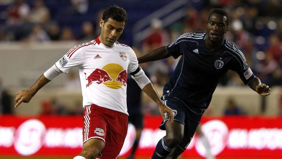HARRISON, NJ - OCTOBER 20:  Rafa Marquez #4 of New York Red Bulls drives by C.J. Sapong #17 of Sporting KC during their match at Red Bull Arena on October 20, 2012 in Harrison, New Jersey.  (Photo by Jeff Zelevansky/Getty Images)