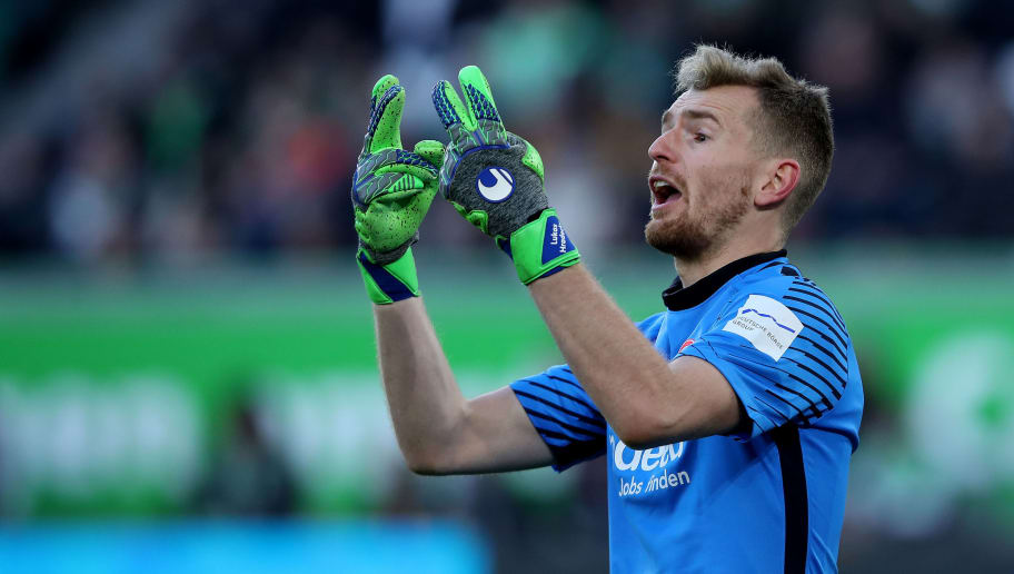 WOLFSBURG, GERMANY - JANUARY 20: Goalkeeper Lukas Hradecky of Frankfurt gestures during the Bundesliga match between VfL Wolfsburg and Eintracht Frankfurt at Volkswagen Arena on January 20, 2018 in Wolfsburg, Germany. (Photo by Ronny Hartmann/Bongarts/Getty Images)