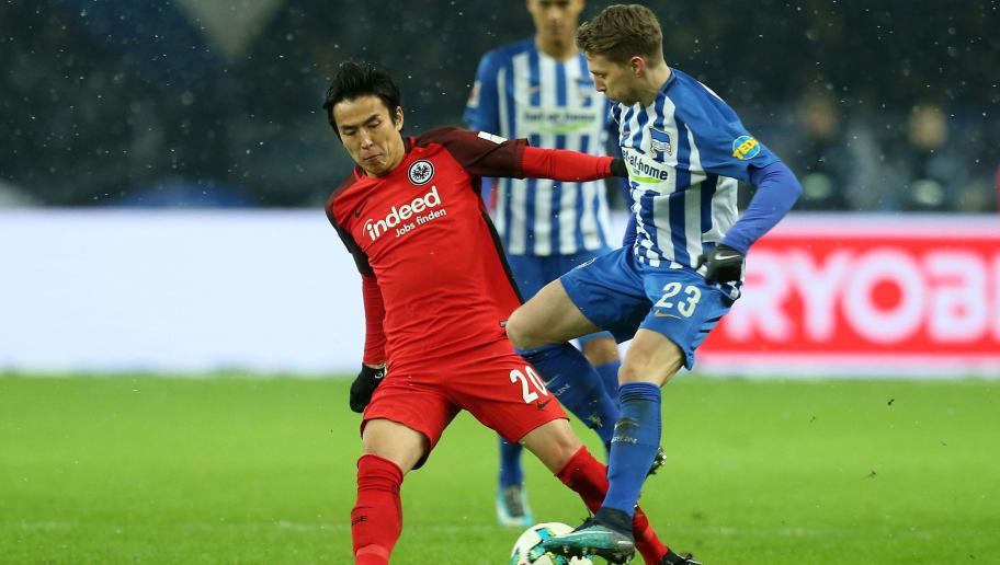 BERLIN, GERMANY - DECEMBER 03:  Mitchell Weiser (R) of Berlin battles for the ball with Makoto Hasebe of Frankfurt during the Bundesliga match between Hertha BSC and Eintracht Frankfurt at Olympiastadion on December 3, 2017 in Berlin, Germany.  (Photo by Matthias Kern/Bongarts/Getty Images)