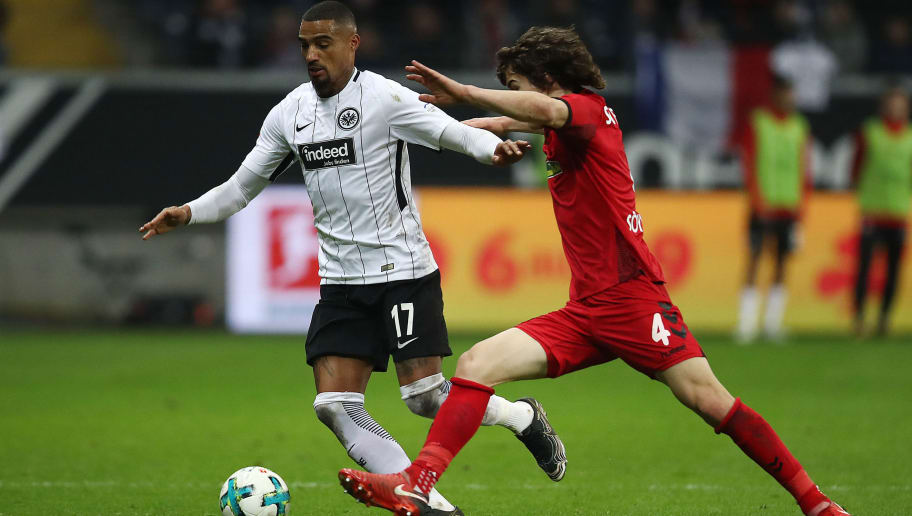 FRANKFURT AM MAIN, GERMANY - JANUARY 13: Kevin Prince-Boateng of Frankfurt (l) fights for the ball with Caglar Soeyuencue of Freiburg during the Bundesliga match between Eintracht Frankfurt and Sport-Club Freiburg at Commerzbank-Arena on January 13, 2018 in Frankfurt am Main, Germany. (Photo by Maja Hitij/Bongarts/Getty Images)