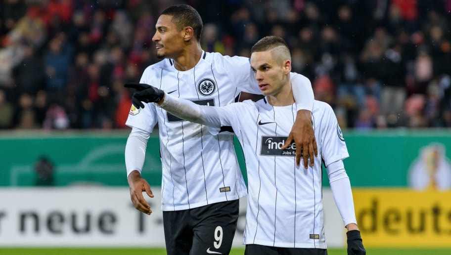 HEIDENHEIM, GERMANY - DECEMBER 20: Mijat Gacinovic of Eintracht Frankfurt celebrates the first goal for his team with his teammates during the DFB Cup match between 1. FC Heidenheim and Eintracht Frankfurt at Voith-Arena on December 20, 2017 in Heidenheim, Germany. (Photo by Alexander Scheuber/Bongarts/Getty Images)