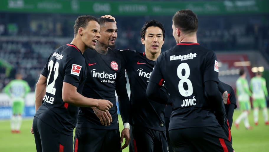 WOLFSBURG, GERMANY - JANUARY 20: (R-L) Luka Jovic of Frankfurt celebrates after scoring his team's third goal with Makoto Hasebe, Kevin-Prince Boateng and Timothy Chandler of Frankfurt during the Bundesliga match between VfL Wolfsburg and Eintracht Frankfurt at Volkswagen Arena on January 20, 2018 in Wolfsburg, Germany. (Photo by Ronny Hartmann/Bongarts/Getty Images)