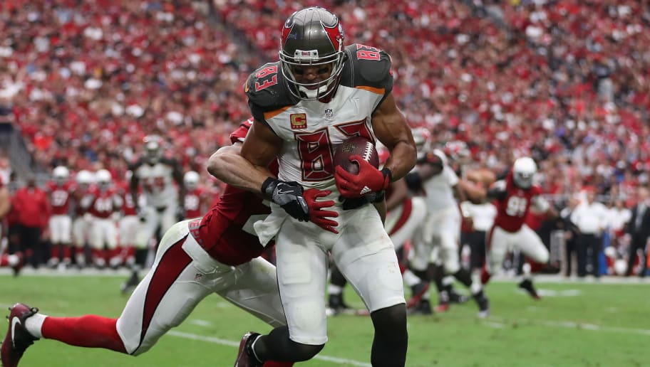 GLENDALE, AZ - SEPTEMBER 18:  Wide receiver Vincent Jackson #83 of the Tampa Bay Buccaneers makes a reception against defensive back Tyvon Branch #27 of the Arizona Cardinals during the third quarter of the NFL game at the University of Phoenix Stadium on September 18, 2016 in Glendale, Arizona. The Cardinals defeated the Buccaneers  40-7.  (Photo by Christian Petersen/Getty Images)
