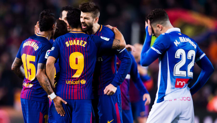 BARCELONA, SPAIN - JANUARY 25: Gerard Pique of FC Barcelona celebrates victory with his teammates Paulinho and Luis Suarez after the Spanish Copa del Rey Quarter Final Second Leg match between FC Barcelona and RCD Espanyol at Camp Nou stadium at Camp Nou on January 25, 2018 in Barcelona, Spain. (Photo by Alex Caparros/Getty Images)