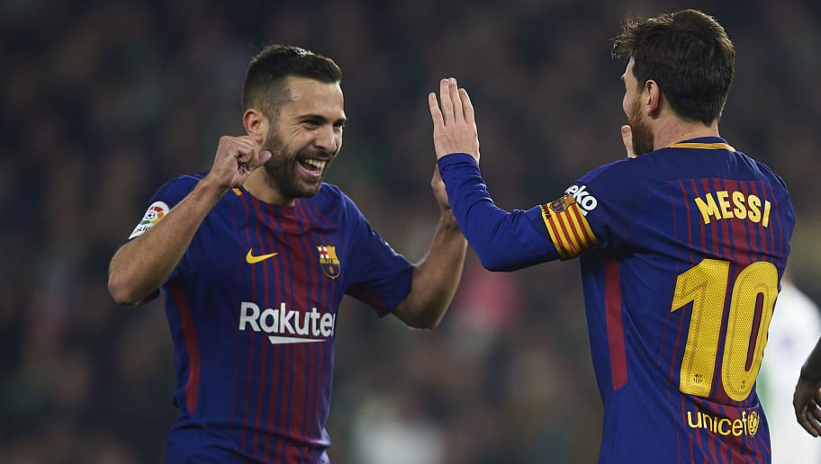 SEVILLE, SPAIN - JANUARY 21:  Lionel Messi of FC Barcelona  celebrates after scoring the second goal for FC Barcelona with his team mate Jordi Alba of FC Barcelona  during the La Liga match between Real Betis and Barcelona at Estadio Benito Villamarin on January 21, 2018 in Seville, .  (Photo by Aitor Alcalde/Getty Images)