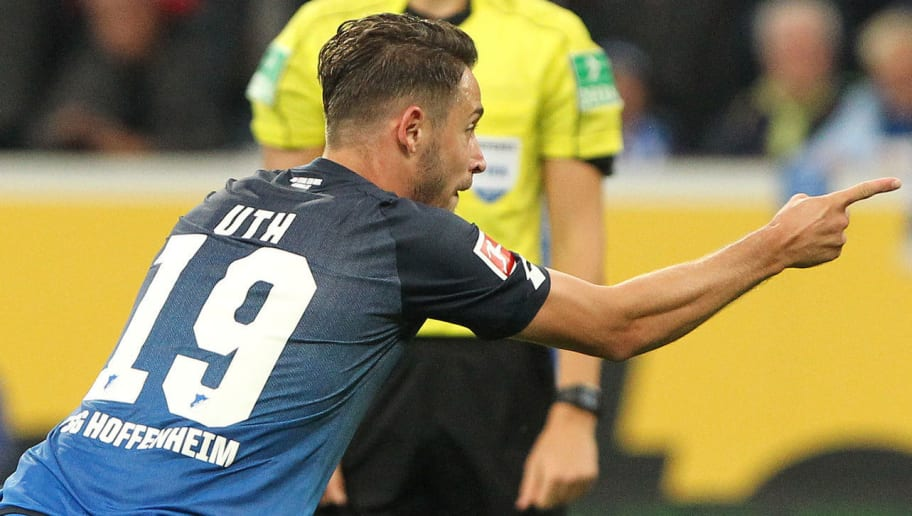 Hoffenheim's German forward Mark Uth celebrates scoring 2-0 during German first division Bundesliga football match between  TSG Hoffenheim and FC Bayern Munich in Sinsheim on September 9, 2017. / AFP PHOTO / Daniel ROLAND / RESTRICTIONS: DURING MATCH TIME: DFL RULES TO LIMIT THE ONLINE USAGE TO 15 PICTURES PER MATCH AND FORBID IMAGE SEQUENCES TO SIMULATE VIDEO. == RESTRICTED TO EDITORIAL USE == FOR FURTHER QUERIES PLEASE CONTACT DFL DIRECTLY AT + 49 69 650050  / RESTRICTIONS: DURING MATCH TIME: DFL RULES TO LIMIT THE ONLINE USAGE TO 15 PICTURES PER MATCH AND FORBID IMAGE SEQUENCES TO SIMULATE VIDEO. == RESTRICTED TO EDITORIAL USE == FOR FURTHER QUERIES PLEASE CONTACT DFL DIRECTLY AT + 49 69 650050        (Photo credit should read DANIEL ROLAND/AFP/Getty Images)