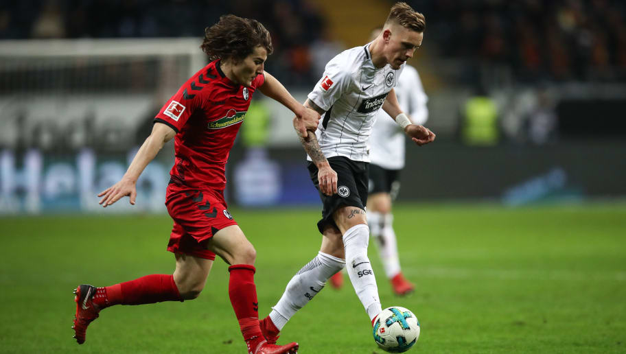FRANKFURT AM MAIN, GERMANY - JANUARY 13: Caglar Soyuncu #4 of SC Freiburg and Marc Stendera #21 of Eintracht Frankfurt battle for the ball during the Bundesliga match between Eintracht Frankfurt and Sport-Club Freiburg at Commerzbank-Arena on January 13, 2018 in Frankfurt am Main, Germany. (Photo by Maja Hitij/Bongarts/Getty Images)