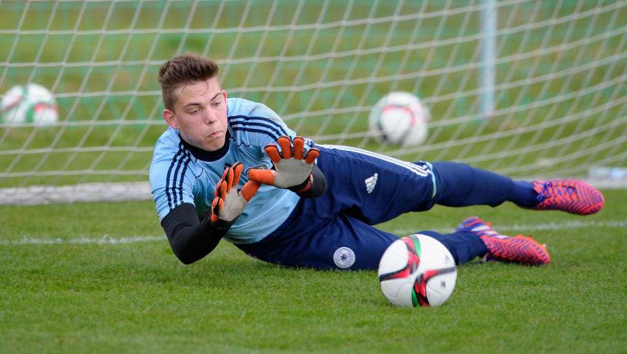 BAD GOEGGING, GERMANY - APRIL 13:  Bennett Philipp Schauer saves a ball during the DFB Goalkeeper Elite Course on April 13, 2015 in Bad Goegging, Germany.  (Photo by Lennart Preiss/Bongarts/Getty Images)