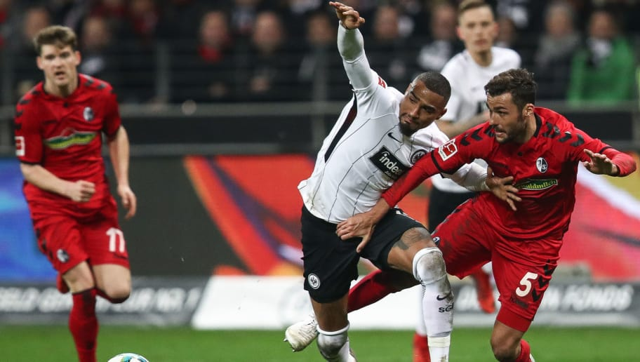 FRANKFURT AM MAIN, GERMANY - JANUARY 13: Kevin-Prince Boateng #17 of Eintracht Frankfurt and Manuel Gulde #5 of SC Freiburg battle for the ball during the Bundesliga match between Eintracht Frankfurt and Sport-Club Freiburg at Commerzbank-Arena on January 13, 2018 in Frankfurt am Main, Germany. (Photo by Maja Hitij/Bongarts/Getty Images)