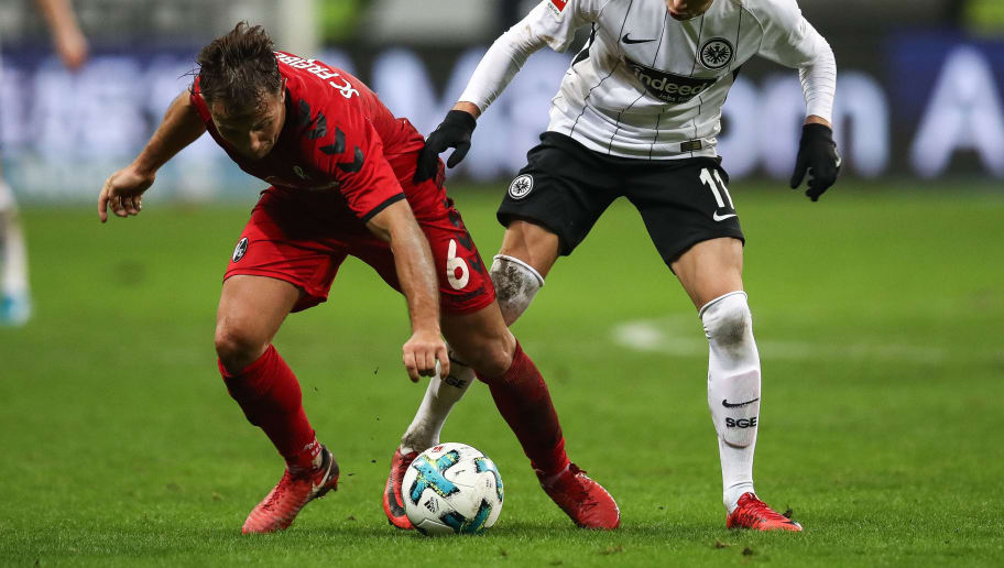 FRANKFURT AM MAIN, GERMANY - JANUARY 13: Amir Abrashi #6 of SC Freiburg (L) and Mijat Gacinovic #11 of Eintracht Frankfurt battle for the ball during the Bundesliga match between Eintracht Frankfurt and Sport-Club Freiburg at Commerzbank-Arena on January 13, 2018 in Frankfurt am Main, Germany. (Photo by Maja Hitij/Bongarts/Getty Images)