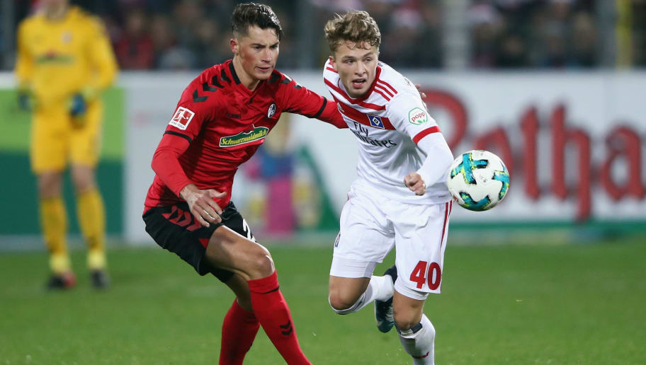 FREIBURG IM BREISGAU, GERMANY - DECEMBER 01:  Jann-Fiete Arp of Hamburg is challenged by Robin Koch of Freiburg during the Bundesliga match between Sport-Club Freiburg and Hamburger SV at Schwarzwald-Stadion on December 1, 2017 in Freiburg im Breisgau, Germany.  (Photo by Alex Grimm/Bongarts/Getty Images)