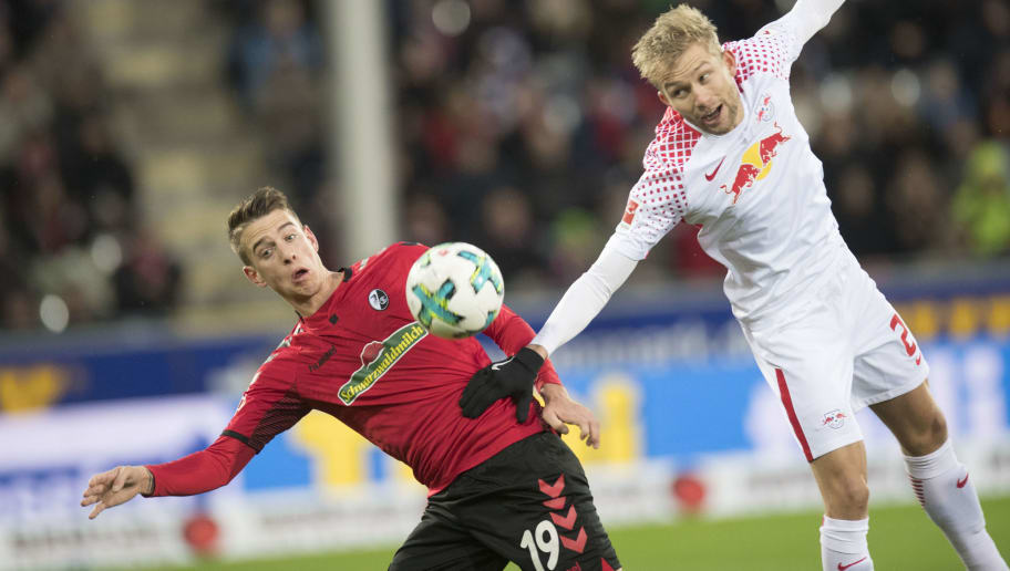 Freiburg's German forward Janik Haberer (L) and Leipzig's Austrian midfielder Konrad Laimer vie for the ball during the German first division Bundesliga football match SC Freiburg vs RB Leipzig in Freiburg, southwestern Germany, on January 20, 2018. / AFP PHOTO / THOMAS KIENZLE / RESTRICTIONS: DURING MATCH TIME: DFL RULES TO LIMIT THE ONLINE USAGE TO 15 PICTURES PER MATCH AND FORBID IMAGE SEQUENCES TO SIMULATE VIDEO. == RESTRICTED TO EDITORIAL USE == FOR FURTHER QUERIES PLEASE CONTACT DFL DIRECTLY AT + 49 69 650050         (Photo credit should read THOMAS KIENZLE/AFP/Getty Images)