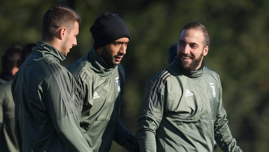 Juventus' defender Medhi Amine Benatia from Morocco (C) and Juventus' forward Gonzalo Higuain from Argentina take part in a training session on the eve of the UEFA Champions League football match Olympiacos Vs Juventus on December 3, 2017 at the 'Juventus Training Center' in Vinovo. / AFP PHOTO / MARCO BERTORELLO        (Photo credit should read MARCO BERTORELLO/AFP/Getty Images)