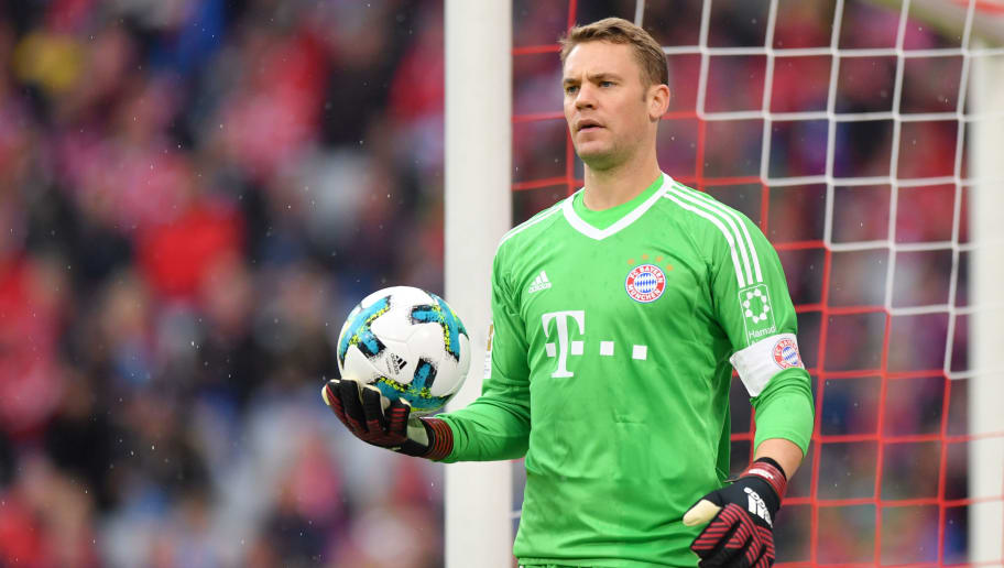 MUNICH, GERMANY - SEPTEMBER 16: Goalkeeper Manuel Neuer of FC Bayern Muenchen holds the ball during the Bundesliga match between FC Bayern Muenchen and 1. FSV Mainz 05 at Allianz Arena on September 16, 2017 in Munich, Germany. (Photo by Sebastian Widmann/Bongarts/Getty Images)